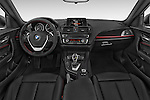 Stock photo of straight dashboard view of a 2015 BMW 2 Series 228I Sport 2 Door Coupe 2WD Dashboard