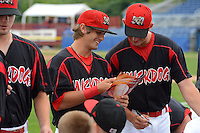 Batavia Muckdogs second baseman Avery Romero (13) and Max Garner look at the team photo while signing autographs before a game against the Hudson Valley Renegades on August 8, 2013 at Dwyer Stadium in Batavia, New York.  The game was cancelled in the third inning with Batavia leading 1-0 due to rain storms.  (Mike Janes/Four Seam Images)