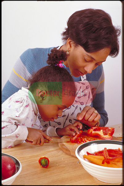 young girl helps mother prepare meal