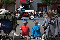 Family watching the Independence Day Parade 2016, Burien, Washington, USA.