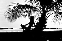 A silhouette at the popular tourist destination and beach playground of Key West in Florida, USA