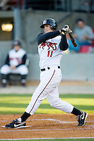 Chris Heisey #11 of the Carolina Mudcats follows through on his swing versus the Jacksonville Suns at Five County Stadium May 19, 2009 in Zebulon, North Carolina. (Photo by Brian Westerholt / Four Seam Images)