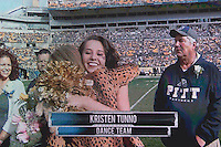 The scoreboard shows Pitt dance girl Kristen Tunno being honored on senior day. The Miami Hurricanes football team defeated the Pitt Panthers 29-24 on  Friday, November 27, 2015 at Heinz Field, Pittsburgh, Pennsylvania.