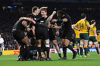 Beauden Barrett of New Zealand is smothered by teammates after scoring a try during the Rugby World Cup Final between New Zealand and Australia - 31/10/2015 - Twickenham Stadium, London<br /> Mandatory Credit: Rob Munro/Stewart Communications