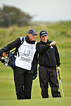 Pic Kenny Smith............. 02/10/2009.Dunhill Links Champioship, St Andrews  Links, Tico Torres lines up his putt on the 17th hole with the help of his caddie