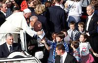 Papa Francesco saluta alcuni bambini al termine di una messa in occasione della Giornata della Famiglia, in Piazza San Pietro, Citta' del Vaticano, 27 ottobre 2013.<br /> Pope Francis greets some children after celebrating a mass on the occasion of the Family Day, in St. Peter's Square at the Vatican, 27 October 2013.<br /> UPDATE IMAGES PRESS/Riccardo De Luca<br /> <br /> STRICTLY ONLY FOR EDITORIAL USE