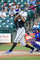 Omaha Storm Chasers outfielder Justin Maxwell (46) follows through on his swing during the Pacific Coast League baseball game against the Round Rock Express on June 1, 2014 at the Dell Diamond in Round Rock, Texas. The Express defeated the Storm Chasers 11-4. (Andrew Woolley/Four Seam Images)