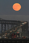 The full moon over the San Rafael Richmond Bridge, CA.