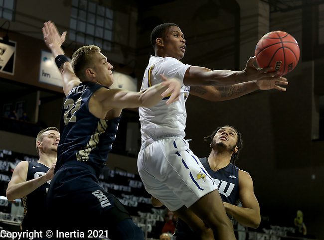 SIOUX FALLS, SD - MARCH 8: Douglas Wilson #35 of the South Dakota State Jackrabbits takes the ball to the basket past Francis Lacis #22 of the Oral Roberts Golden Eagles during the Summit League Basketball Tournament at the Sanford Pentagon in Sioux Falls, SD. (Photo by Dave Eggen/Inertia)