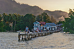 Locals congregate to fish or just enjoy the sea breeze on the pier at Wori, North Sulawesi, Indonesia.  This is where boats for Siladen Island pick up and drop of guests.