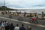 Anthony Perez (FRA) Cofidis, Jérémy Cabot (FRA) TotalEnergies and Ide Schelling (NED) Bora-Hansgrohe from the breakaway ride along the coastline during Stage 2 of the 2021 Tour de France, running 183.5km from Perros-Guirec to Mur-de-Bretagne Guerledan, France. 27th June 2021.  <br /> Picture: A.S.O./Charly Lopez   Cyclefile<br /> <br /> All photos usage must carry mandatory copyright credit (© Cyclefile   A.S.O./Charly Lopez)
