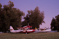 Two Grumman Widgeons,  N3TD, a SCAN Type 30, in the foreground and N8661, a Grumman G-44A , parked at the Natural High School field, Clear Lake Seaplane Splash-In, Lakeport, Lake County, California at dusk.  The SCAN Type 30 is a Grumman G-44 built under license by Societe de Constructions AeroNavales de PortNeuf (SCAN).