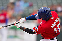 Round Rock Express second baseman Jurickson Profar #10 swings the bat against the Omaha Storm Chasers in the Pacific Coast League baseball game on April 7, 2013 at the Dell Diamond in Round Rock, Texas. Omaha beat Round Rock 5-2, handing the Express their first loss of the season. (Andrew Woolley/Four Seam Images).