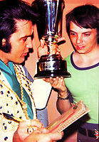 BNPS.co.uk (01202 558833)<br /> Pic: Todd Slaughter/BNPS<br /> <br /> Pictured: Todd Slaughter with Elvis 1973.<br /> <br /> One of the world's most renowned Elvis Presley fan clubs is expected to sell for a staggering £100,000.<br /> <br /> The Official Elvis Presley Fan Club of Great Britain was established in London in 1957 and has a membership of almost 5,000 people over 60 years on.<br /> <br /> The current president, Todd Slaughter, bought it in 1967 after working as a journalist on music magazines.