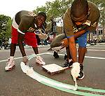 Lance Stephenson, left, and Erving Walker paint a line on a basketball court in New York City as part of their volunteer service on August 31, 2006.  The players were in town for the Elite 24 Hoops Classic, which brought together the top 24 high school basketball players in the country regardless of class or sneaker affiliation.
