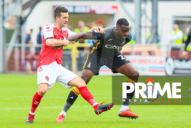 Jason Holt of Fleetwood Town and Hope Akpan of Bradford City during the Sky Bet League 1 match between Fleetwood Town and Bradford City at Highbury Stadium, Fleetwood, England on 1 September 2018. Photo by Thomas Gadd.