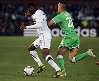 Foued Kadir ((right) of Argelia and Maurice Edu (left) of USA. USA defeated Algeria 1-0 in stoppage time in the 2010 FIFA World Cup at Loftus Versfeld Stadium in Pretoria, Sourth Africa, on June 23th, 2010.
