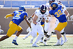 BROOKINGS, SD - APRIL 24: Holy Cross Crusaders running back Peter Oliver #24 looks for running room past South Dakota State Jackrabbits safety Isaiah Stalbird #2 at Dana J Dykhouse Stadium on April 24, 2021 in Brookings, South Dakota. (Photo by Dave Eggen/Inertia)