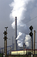 Smog comes out from the factory of Benxi Iron and Steel Group in Liaoning. China's second-largest steelmaker Anshan Iron & Steel Group has merged with smaller rival Benxi Steel Group to create a company with capacity that will match the mainland's biggest steelmaker, Shanghai Baosteel Group..22 Aug 2005