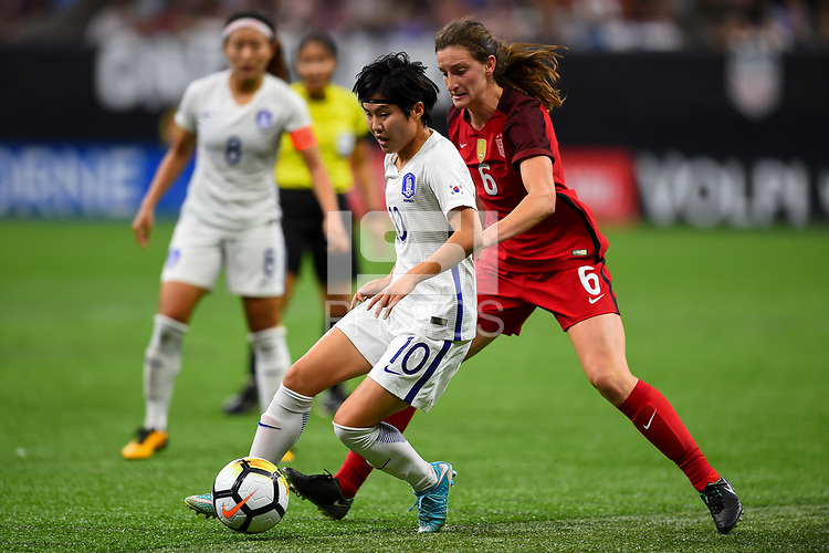 New Orleans, LA - Thursday October 19, 2017: Ji Soyun, Andi Sullivan during an International friendly match between the Women's National teams of the United States (USA) and South Korea (KOR) at Mercedes Benz Superdome.