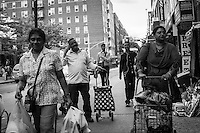 In the backstage of Jackson Heights' intensely diversified social pattern, the presence of young mid-class people isn't a rarity anymore. Relocating from upscaled areas of Manhattan they can still afford local rising prices. Jackson Hts, Queens, New York City.