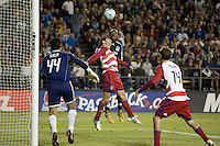 Peguero Jean Phillipe heads the ball towards goal as FC Dallas' Duilio Davino defends in front. The San Jose Earthquakes tied FC Dallas 0-0, at Buck Shaw Stadium, in Santa Clara, California, Saturday, May 3, 2008. .