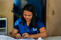 Kessia Zelaya, the workshop manager, sews a white dress, dyed with a natural blue indigo afterwards, in an artisanal clothing workshop in Santiago Nonualco, El Salvador, 6 April 2018. For centuries, indigo, a natural deep blue dye extracted from the leaves of tropical plants, has been known to the native indigenous inhabitants of Central America. Nowadays, a growing demand for handmade, nature-based products has has permitted the emergence of various clothing workshops and cooperatives. Employing traditional design techniques and inspired by the ancient Mayan artists, they produce fashion collections, clothing accessories or decorative items on a sustainable, small scale basis.