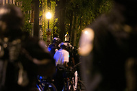 A demonstrator records as police move in to disperse protestors gathered in Washington, D.C., U.S., on Monday, June 1, 2020, following the death of an unarmed black man at the hands of Minnesota police on May 25, 2020.  More than 200 active duty military police were deployed to Washington D.C. following three days of protests.  Credit: Stefani Reynolds / CNP/AdMedia