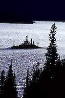 Silhouette of Saint Mary Lake with an island and  trees