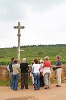 Vineyard. Group of visitors in front of La Romanee Conti Grand Cru. Vosne Romanee, Cote de Nuits, d'Or, Burgundy, France