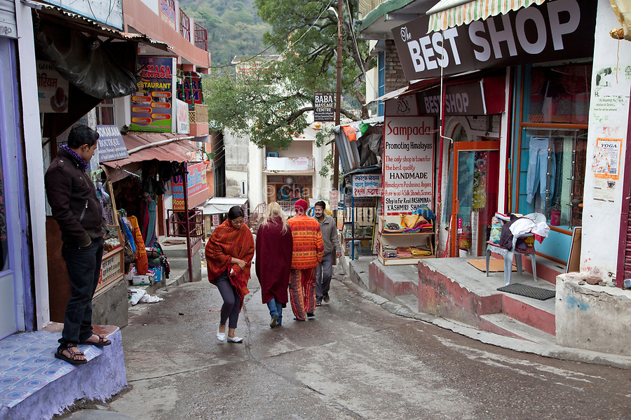 India, Rishikesh.  Street Scene.  Souvenir Shops and Restaurants line the Streets Leading down to the Ganges (Ganga).