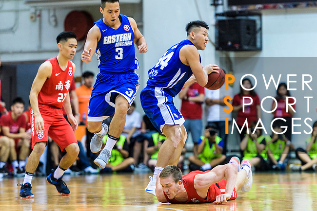 Dominic Robert Gilbert #11 of SCAA Men's Basketball Team (R) fights for the ball with Tang Chi Hang #14 of Eastern Long Lions (C) during the Final of Hong Kong Basketball League 2018 match between SCAA v Eastern Long Lions on August 10, 2018 in Hong Kong, Hong Kong. Photo by Marcio Rodrigo Machado/Power Sport Images