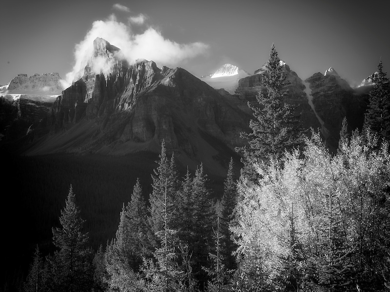 Early morning sunrise on peaks around Moraine Lake with fall color. Banff National Park. Alberta Canada.