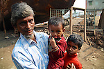A worker at the shipyard in Old Dhaka asked to have his picture taken with his two sons
