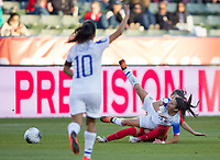 CARSON, CA - FEBRUARY 07: Lixy Rodriguez #12 of Costa Rica takes a tumble during a game between Canada and Costa Rica at Dignity Health Sports Park on February 07, 2020 in Carson, California.