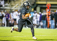 Joshua Ficklin (1) of  Bentonville runs  the ball against with Fayetteville in pursuit at Tigers Stadium, Bentonville, Arkansas on Friday, October 16, 2020 / Special to NWA Democrat-Gazette/ David Beach
