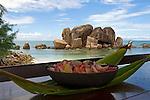 """Seychelles, Island Praslin, Anse Bateau: view from Restaurant Les Rocher across ocean with granite rocks """"Grosse Roche"""""""