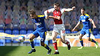 Ayoub Assal of AFC Wimbledon tries to shake off a challenge from Fleetwood Town's Jordan Rossiter  during AFC Wimbledon vs Fleetwood Town, Sky Bet EFL League 1 Football at Plough Lane on 5th April 2021