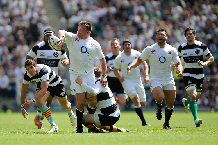 David Wilson of England offloads as he is tackled during the match between England and Barbarians at Twickenham on Sunday 26th May 2013 (Photo by Rob Munro)