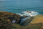 Fajardo, Puerto Rico<br /> September 6, 2021<br /> <br /> Oxanna Suau climbs the rocks above a shoreline cove in north-eastern Puerto Rico.