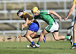 David Reidy of  Clare  in action against Tom Morrissey of  Limerick during their NHL quarter final at the Gaelic Grounds. Photograph by John Kelly.