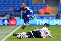 Jazz Richards of Cardiff City is tackled by Dennis Adeniran of Fulham during the The Emirates FA Cup 3rd Round match between Cardiff City and Fulham at The Cardiff City Stadium, Wales, UK. Sunday 08 January 2017
