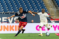 FOXBOROUGH, MA - AUGUST 5: Jay Tee Kamara #19 of North Carolina FC passes the ball as Sean O'Hearn #40 of New England Revolution II defends during a game between North Carolina FC and New England Revolution II at Gillette Stadium on August 5, 2021 in Foxborough, Massachusetts.