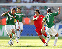 Mehdi Mahdavikia of Iran tries to move past Mario Mendez and Rafa Marquez of Mexico. Mexico defeated Iran 3-1 during a World Cup Group D match at Franken-Stadion, Nuremberg, Germany on Sunday June 11, 2006.