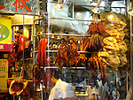 Peking Duck and chinese sausages in a restaurant.