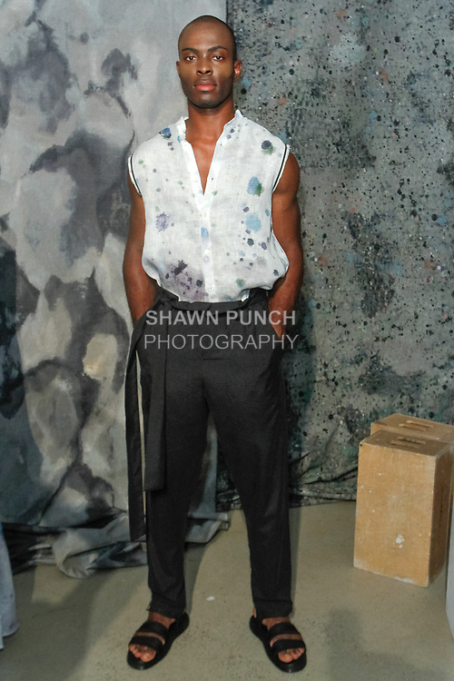 Model poses in an outfit from the R. Swiader Spring Summer 2018 collection by Rafal Swiader, for New York Mens Day at Dune Studios on July 10, 2017; duing New York Fashion Week: Mens Spring Summer 2018.
