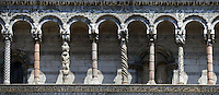 Panorama of the Arcades of St Michele of the 13th century Romanesque facade of the San Michele in Foro,  a Roman Catholic basilica church in Lucca, Tunscany, Italy