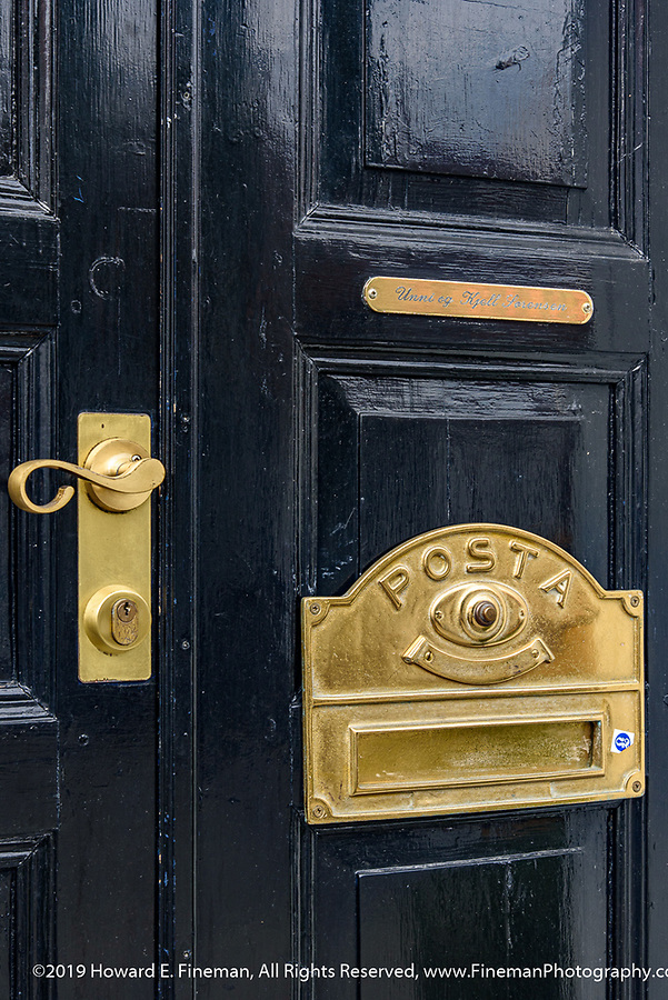 Traditional door and brass hardware in Kristiansand