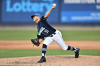 Asheville Tourists pitcher Colton Harlow (31) delivers a pitch during a game against the Lakewood BlueClaws at McCormick Field on June 15, 2019 in Asheville, North Carolina. The BlueClaws defeated the Tourists 4-2. (Tony Farlow/Four Seam Images)
