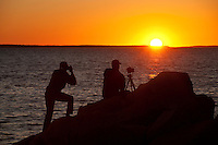 Photographers shooting coastal sunset.